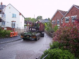 Heavy lorry negotiating the bend by Millhayes