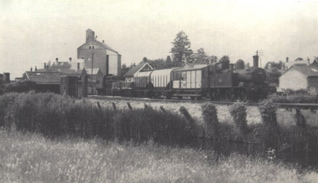 1451 with mixed train at Uffculme, running alongside the River Culm, July 1962