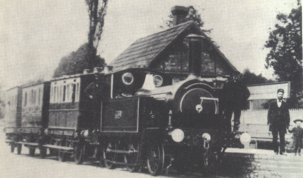 2-4-0T No 1300 on a short train of four wheeled coaches at Uffculme, circa 1882