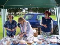 Cake stall at fete. L-R Patricia Fuller, Sheila Pretty and Meg Palmer