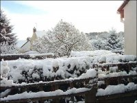 The house of Ted Collins - covered in snow